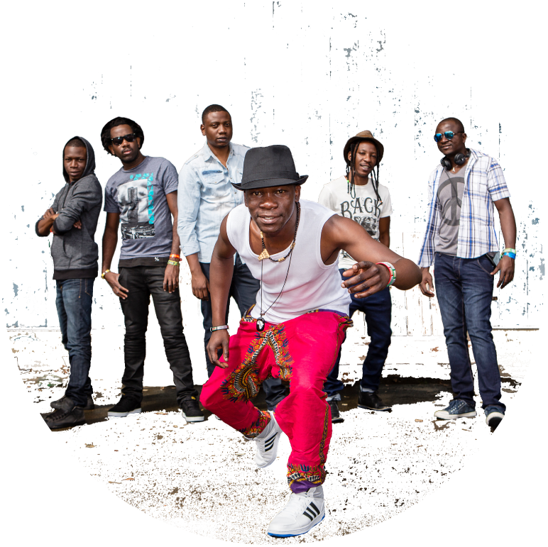 Frontman of Mokoomba stands in front of the other 5 members, smiling at the camera