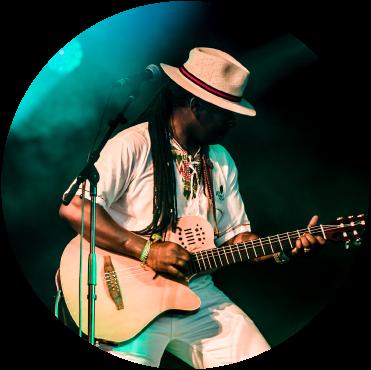 Aurelio plays guitar live on stage