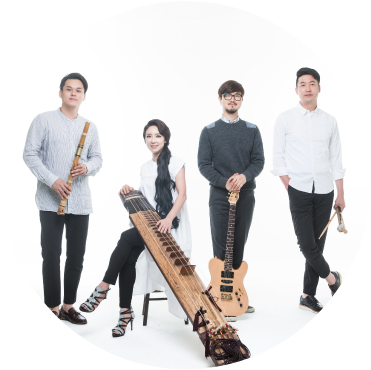 Black String Band Stands dressed up holding instruments against white background