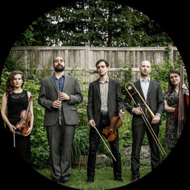 Ezekiel's Wheels Klezmer Band stands in backyard holding instruments