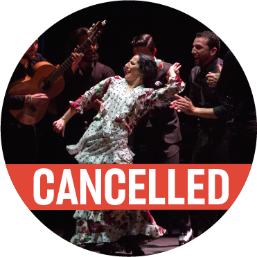 "Mercedes Ruiz in white dress surrounded by musicians with a poppy colored ""cancelled"" banner over the image"