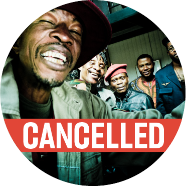 """Lead singer closest to the camera in a green jacket with a hat, with four members of the band standing behind him with a """"cancelled""""  banner going across the image"""