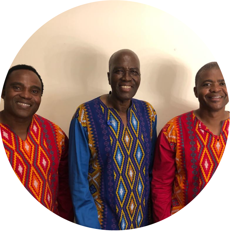 Thulani Shabalala, Albert Mazibuko and Sibongiseni Shabalala stand in front of an off white wall smiling