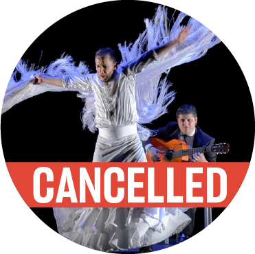 "Dancing in a white skirt and top with fringe hanging down from Manuel Linan's outstretched arms with a poppy colored ""cancelled"" banner over the image"