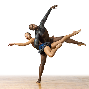Philadanco! male and female dancer strike a pose to create a cross in front of a white background