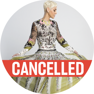 "Mariza standing with her arms holding up a beautifully detailed green, silver, and black dress while looking off to the side with a ""cancelled"" banner over the image"