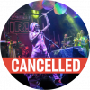 "Antibalas performing live. Chinese lanterns hang in the air and the frontman is holding the mic stand in the air. A red colored ""cancelled"" banner goes across the image."