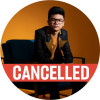 Joey Alexander sits in a black chair with a black denim jacket and yellow lapels against a yellow background with a cancelled banner over the image