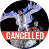 """Dancing in a white skirt and top with fringe hanging down from Manuel Linan's outstretched arms with a poppy colored """"cancelled"""" banner over the image"""