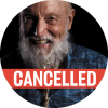 "Portrait of Terry Riley with a poppy colored ""cancelled"" banner over the image"