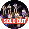 Juan de Marcos & The Afro-Cuban All Stars performing on stage in white attire